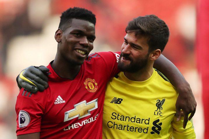 Paul Pogba (Man. United) i Alisson Becker (Liverpool)/Foto REUTERS