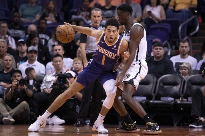 Devin Booker (Phoenix Suns) i Caris LeVert (Brooklyn Netse)/Foto REUTERS