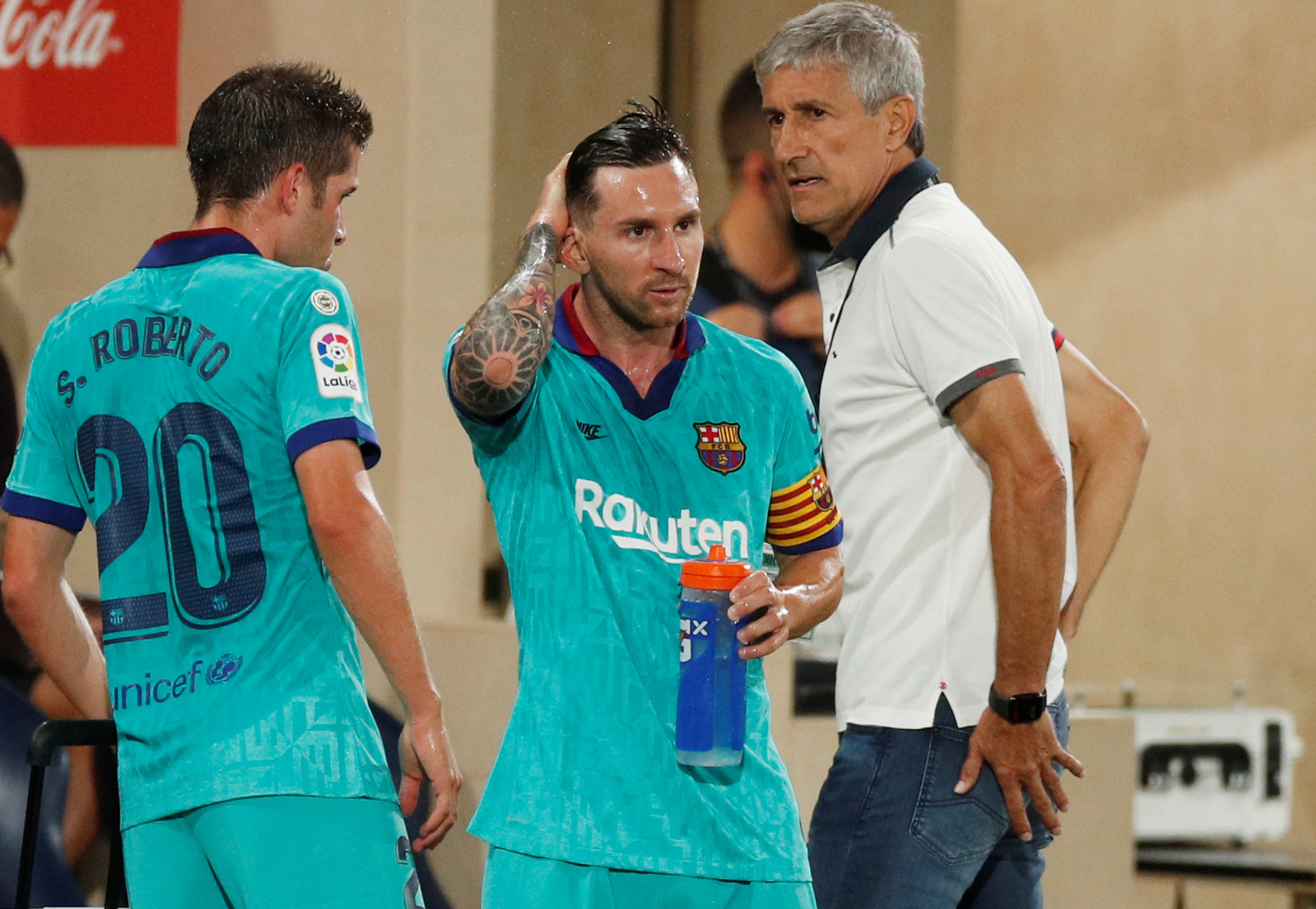 Leo Messi u društvu trenera Setiena/Foto REUTERS