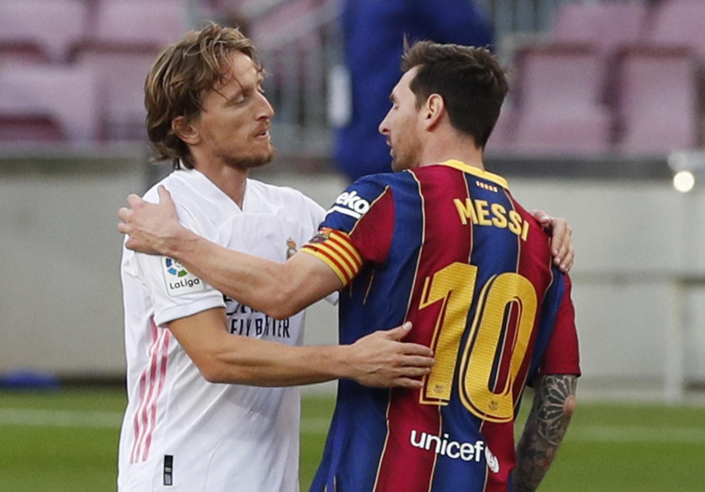 Luka Modrić i Leo Messi/Foto REUTERS