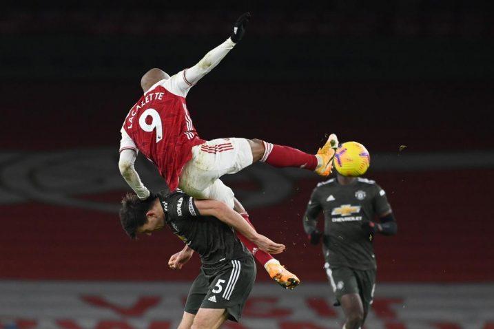 Harry Maguire (Man United) i Alexandre Lacazette (Arsenal)/Foto REUTERS