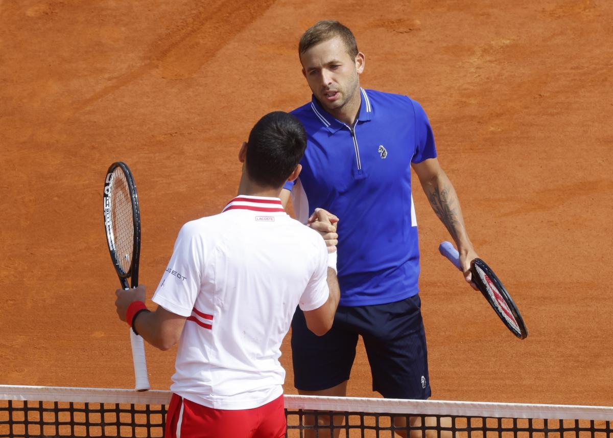 Daniel Evans i Novak Đoković/Foto: REUTERS